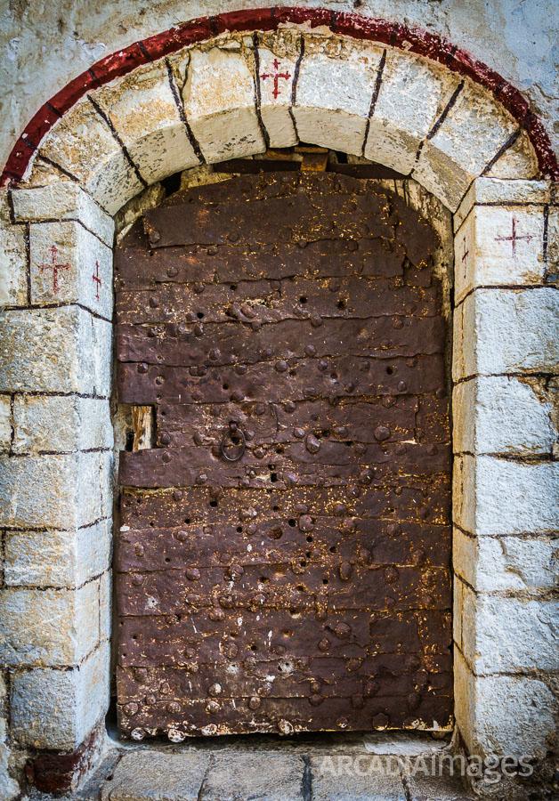 The main gate to the Prodromou Monastery full of bullet holes. Arcadia, Peloponnese