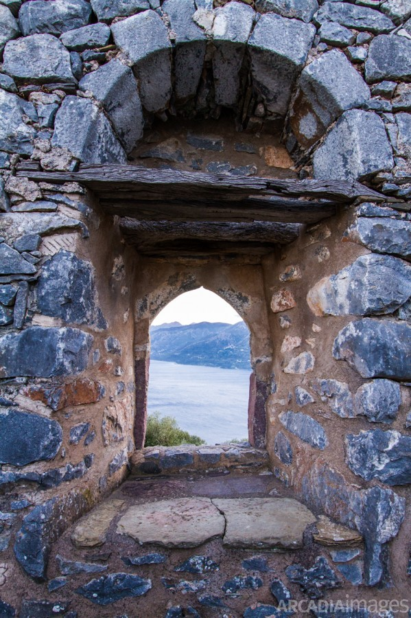 A window in the wall of Sotiros Monastery looking to Laconian Bay