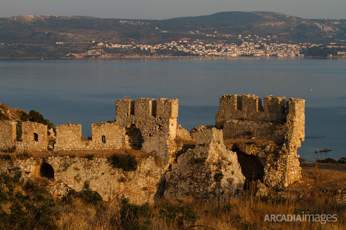 Paleokastro Castle built in 1278 by the Franks and Pylos town in the background. Navarino Bay, Messenia, Peloponnese
