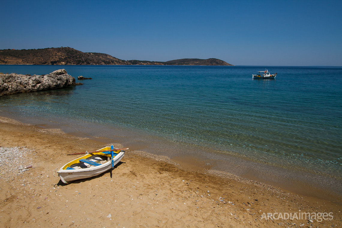 Fishing boats at Aghia Varvara (Saint Barbara) beach, named after the Byzantine chapel on the middle of it. Skoutari, Laconia, Peloponnese
