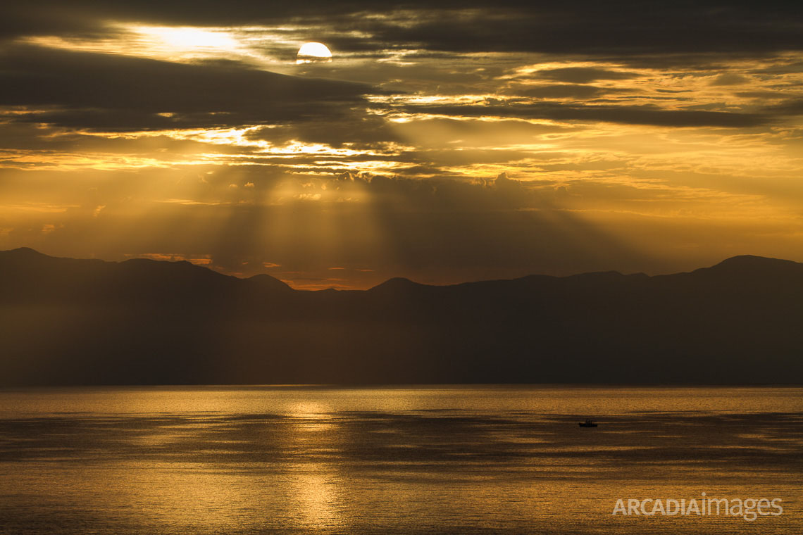 Sunrise light on the Messenian gulf as seen from Peroulia village. Messenia, Peloponnese, Greece